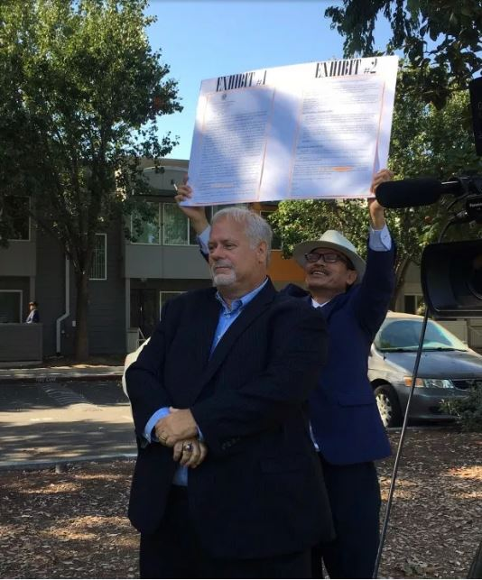 Mark Tiernan, a supporter of Van Le and CEO of the Milpitas Chamber of Commerce, deliberately stands in front of San Jose City Councilman Tam Nguyen during a raucous press conference in that city on Aug. 15. Photo by Ramona Giwargis/Bay Area News Group