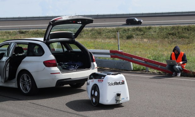 An engineer works with a TeleRetail transporter robot on Monday, Aug. 21, 2017, at Aldenhoven Test Track in Germany. (TeleRetail photo)