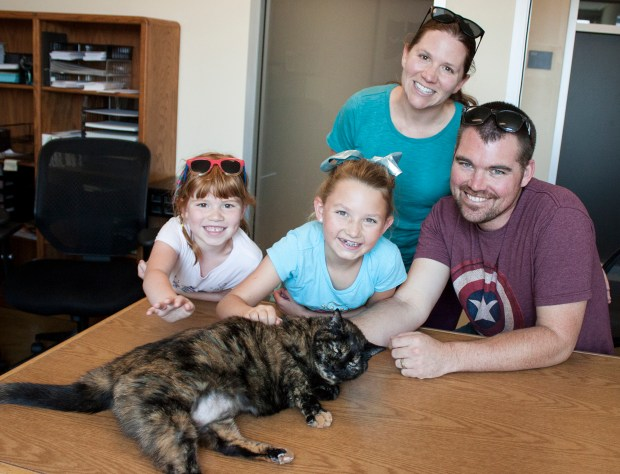 Kelly Still, standing, her husband Taylor, their children, and their new cat at the Clear the Shelter event at Peninsula Humane Society & SPCA. The event, on Aug. 19-20, saw 82 animals be adopted. (Peninsula Humane Society & SPCA photo)