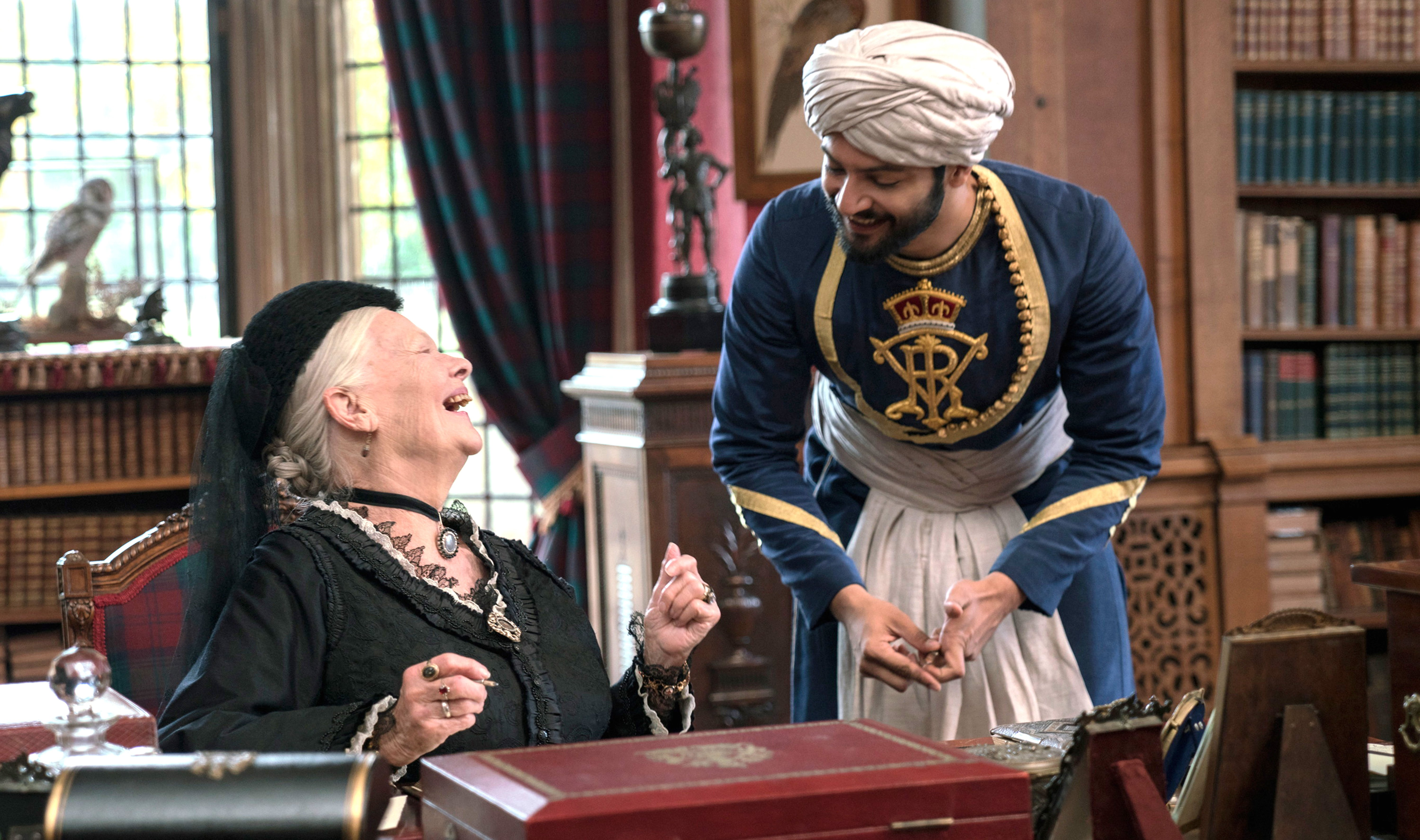 """Judi Dench, left, plays Queen Victoria, and Ali Fazal plays Abdul Karim, an Indian Muslim whom she employs as her personal servant """"Victoria and Abdul."""" (Peter Mountain/Focus Features)"""