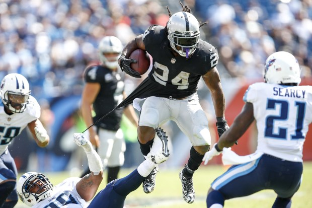 Running back Marshawn Lynch #24 of the Oakland Raiders runs the ball against the Tennessee Titans in the second half at Nissan Stadium on September 10, 2017 In Nashville, Tennessee. (Photo by Wesley Hitt/Getty Images) )