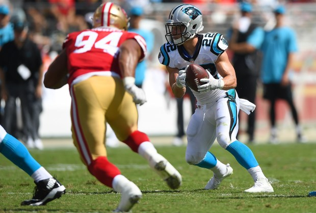 Christian McCaffrey #22 of the Carolina Panthers carries the ball while pursued by Solomon Thomas #94 of the San Francisco 49ers during the second quarter of their NFL football game at Levi's Stadium on September 10, 2017 in Santa Clara, California. (Photo by Thearon W. Henderson/Getty Images)