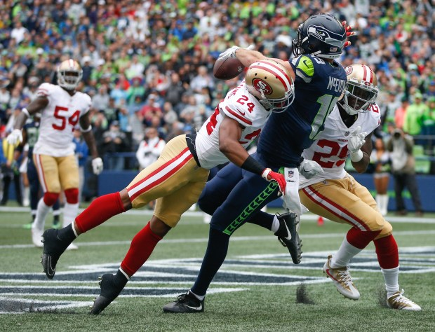 Wide receiver Tanner McEvoy (19) of the Seattle Seahawks can't bring in a pass against cornerback K'Waun Williams (24) and safety Jaquiski Tartt (29) of the San Francisco 49ers in the first quarter during the game at CenturyLink Field on September 17, 2017, in Seattle. (Otto Greule Jr /Getty Images)