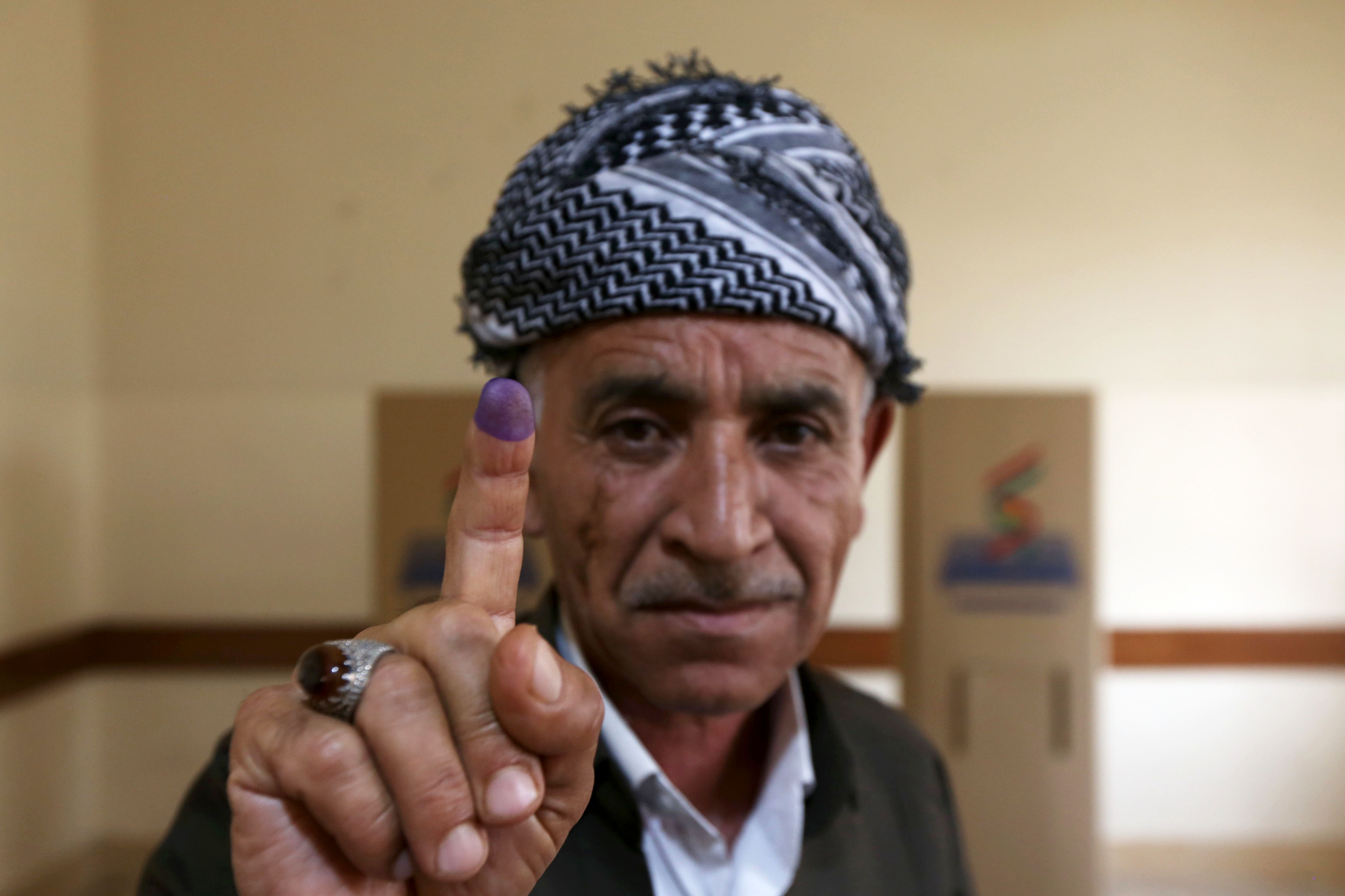 An Iraqi Kurdish man shows his ink-stained finger after voting in the Kurdish independence referendum in Arbil, the capital of the autonomous Kurdish region of northern Iraq, on September 25, 2017. / AFP PHOTO / SAFIN HAMEDSAFIN HAMED/AFP/Getty Images