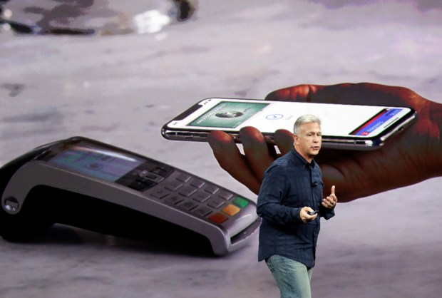 Phil Schiller, Apple's senior vice president of worldwide marketing, announces features of the new iPhone X at the Steve Jobs Theater on the new Apple campus on Tuesday, Sept. 12, 2017, in Cupertino, Calif. (AP Photo/Marcio Jose Sanchez)
