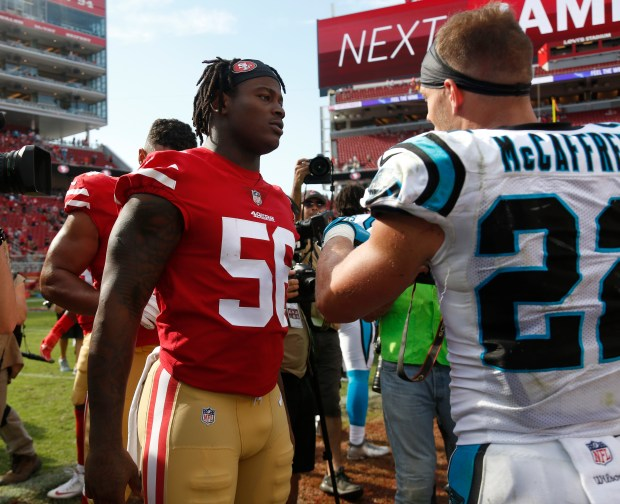San Francisco 49ers' Reuben Foster (56) talks to Carolina Panthers' Christian McCaffrey (22) following the Panthers 23-3 win for their NFL game at Levi's Stadium in Santa Clara, Calif., on Sunday, September 10, 2017. (Nhat V. Meyer/Bay Area News Group)
