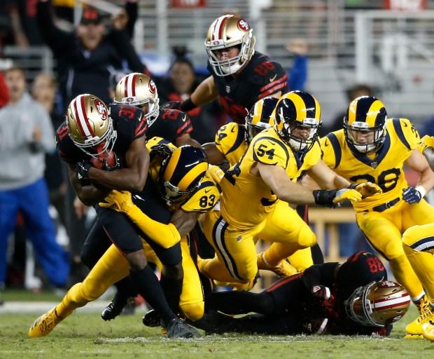 San Francisco 49ers' Raheem Mostert (31) intercept the ball against Los Angeles Rams' Josh Reynolds (83) in the fourth quarter of their NFL game at Levi's Stadium in Santa Clara, Calif., on Thursday, September 21, 2017. (Josie Lepe/Bay Area News Group)