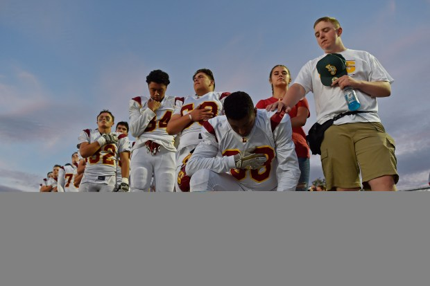 Liberty's Michael Cole III (88) takes a knee during the playing of the national anthem before their game against Hertiage at Heritage High School in Brentwood, Calif., on Friday, Sept. 29, 2017. (Jose Carlos Fajardo/Bay Area News Group)