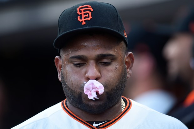 San Francisco Giants Pablo Sandoval (48) pops a bubble while in the dugout before their game against the Philadelphia Phillies at AT&T Park in San Francisco, Calif. on Thursday, Aug. 17, 2017. (Jose Carlos Fajardo/Bay Area News Group)