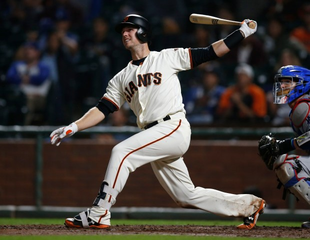 San Francisco Giants' Buster Posey (28) hits an RBI double against the Los Angeles Dodgers in the seventh inning at AT&T Park in San Francisco, Calif., on Tuesday, September 12, 2017. (Nhat V. Meyer/Bay Area News Group)