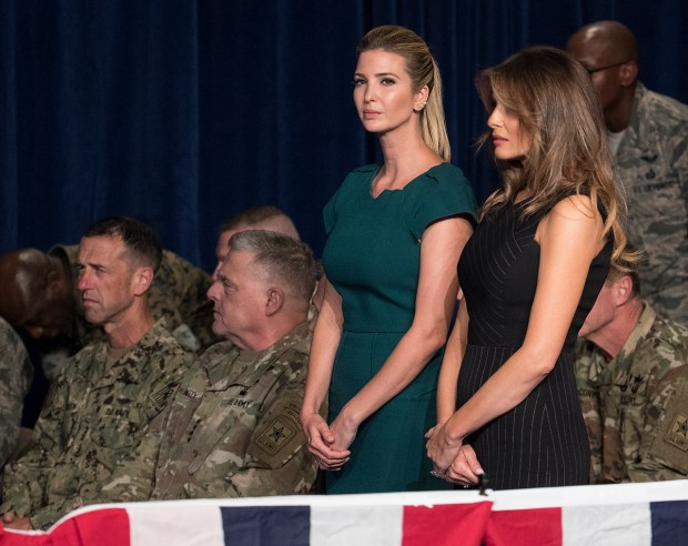 Ivanka Trump, the daughter of President Donald Trump, and first lady Melania Trump stand together before President Donald Trump arrives to speak at Fort Myer in Arlington Va., Monday, Aug. 21, 2017, during a Presidential Address to the Nation about a strategy he believes will best position the U.S. to eventually declare victory in Afghanistan. (AP Photo/Carolyn Kaster)