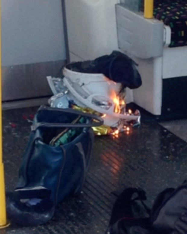 In this image made from video, an explosive device burns in a train at a southwest London subway station in London Friday, Sept. 15, 2017.(@RRIGS via AP)
