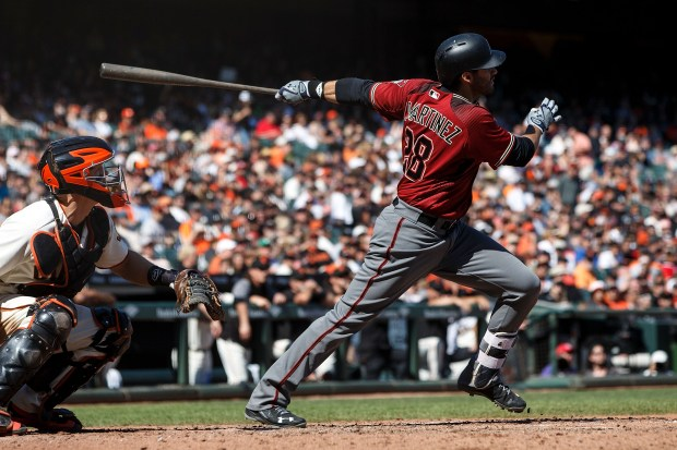 J.D. Martinez #28 of the Arizona Diamondbacks hits a two run home run against the San Francisco Giants during the sixth inning at AT&T Park on September 17, 2017 in San Francisco, California. The San Francisco Giants defeated the Arizona Diamondbacks 7-2. (Photo by Jason O. Watson/Getty Images)