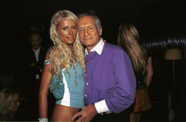 WEST HOLLYWOOD, CA - JUNE 6: Playboy Founder Hugh Hefner(R) and Heiress Paris Hilton pose at The Standard Club June 6, 2003 in West Hollywood, California. (Photo by David Klein/Getty Images)