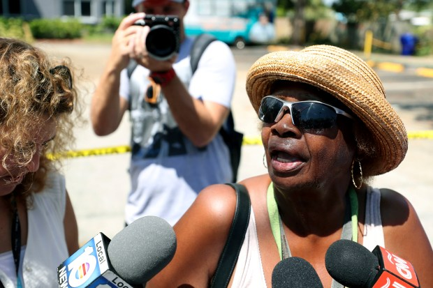Flora Mitchell answers questions from the media outside the Rehabilitation Center at Hollywood Hills in Hollywood, Fla., Wednesday, Sept. 13, 2017. Several patients at the sweltering nursing home died in Hurricane Irma's aftermath amid widespread power outages. Mitchell arrived at the home trying to find out what happened to her 58-year-old sister, Vonda Wilson, a stroke patient who lived there for about 10 years. She said she last heard from her sister two days ago and found out the air conditioning was not working. (John McCall/South Florida Sun-Sentinel via AP)