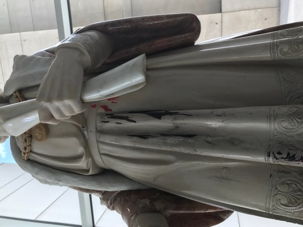 A few splatters of red paint remain after the Christopher Columbus statue was vandalized on Thursday