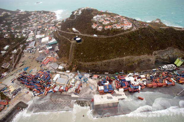 This Sept. 6, 2017 photo provided by the Dutch Defense Ministry shows a view of St. Maarten, in the aftermath of Hurricane Irma. Irma cut a path of devastation across the northern Caribbean, leaving thousands homeless after destroying buildings and uprooting trees. Significant damage was reported on the island that is split between French and Dutch control. (Gerben Van Es/Dutch Defense Ministry via AP)