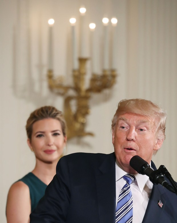 WASHINGTON, DC - AUGUST 01: U.S President Donald Trump speaks about small businesses while daughter and advisor to the President Ivanka Trump listens, during event in the East Room at the White House on August 1, 2017 in Washington, DC. (Photo by Mark Wilson/Getty Images)