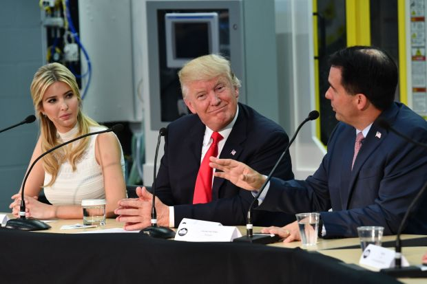 US President Donald Trump and his daughter Ivanka (L) chair a workforce development roundtable discussion with Wisconsin Governor Scott Walker (R) at Waukesha County Technical College during a visit in Milwaukee, Wisconsin on June 13, 2017. / AFP PHOTO / Nicholas Kamm (Photo credit should read NICHOLAS KAMM/AFP/Getty Images)