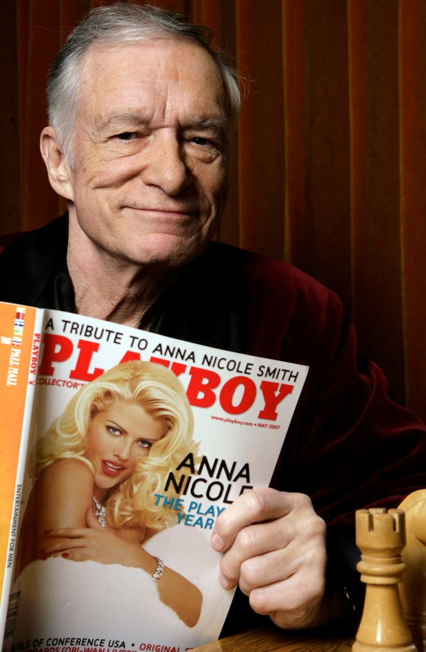 FILE - In this April 5, 2007 file photo, Hugh Hefner poses for a photo at the Playboy Mansion in Los Angeles. Playboy magazine founder and sexual revolution symbol Hefner has died at age 91. The magazine released a statement saying Hefner died at his home in Los Angeles of natural causes on Wednesday night, Sept. 27, 2017, surrounded by family. (AP Photo/Damian Dovarganes, File)