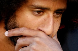 San Francisco 49ers quarterback Colin Kaepernick (7) covers is mouth as he kneels during the national anthem before their NFL game against Arizona Cardinals at Levi's Stadium in Santa Clara, Calif., on Thursday, Oct. 6, 2016. (Josie Lepe/Bay Area News Group)
