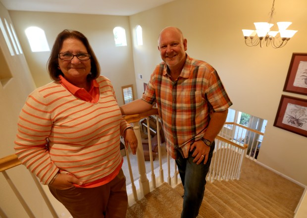 Jim and Lisa Suth are photographed inside their home on South Dublin Ranch Drive in Dublin, Calif., on Tuesday, Sept. 19, 2017. The couple are selling their home and moving a few exits down the freeway to Livermore. (Jane Tyska/Bay Area News Group)
