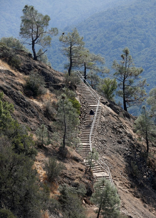 A visitor hikes one of the new staircases after the opening ceremony for the new public space atop Mount Umunhum near San Jose, California, Saturday, Sept. 16, 2017. The Midpeninsula Regional Open Space District, a public agency that owns the 3,486-foot peak in the Santa Cruz Mountains east of Los Gatos, spent $25 million over eight years on the project. (Patrick Tehan/Bay Area News Group)