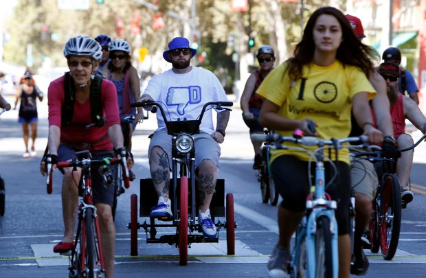 Cyclists celebrate Viva CalleSJ pedaling up a car-free First Street in San Jose, Calif., Sunday Oct. 11, 2015. Hundreds of people, some carrying dogs, took over six miles of the city's busy streets for a day-long party. (Karl Mondon/Bay Area News Group)