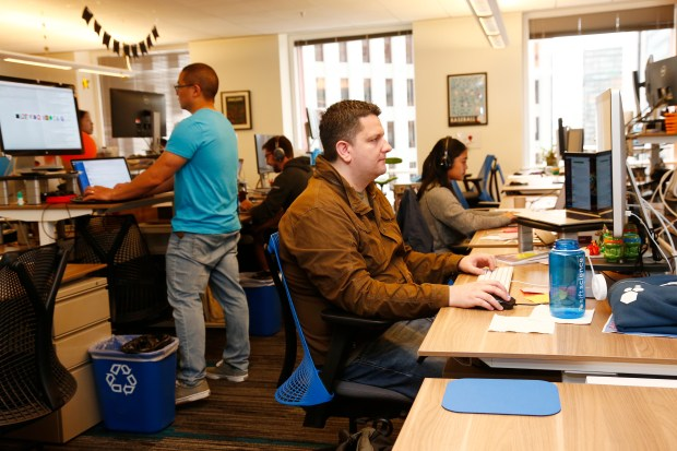 Tyler Moore, foreground, works in the headquarters of Sift Science in San Francisco, California, on Wednesday, Sept. 20, 2017. Sift Science provides fraud detection solutions for online businesses. (Gary Reyes/ Bay Area News Group)