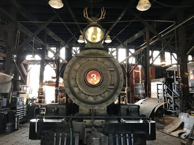 """The Sierra No. 3 locomotive still steams past the """"Petticoat Junction""""water tower at Jamestown's Railtown 1897 State Historic Park, and the movie prop gallery and outdoor exhibits include several photo op spots. (Jackie Burrell/Bay Area News Group)"""