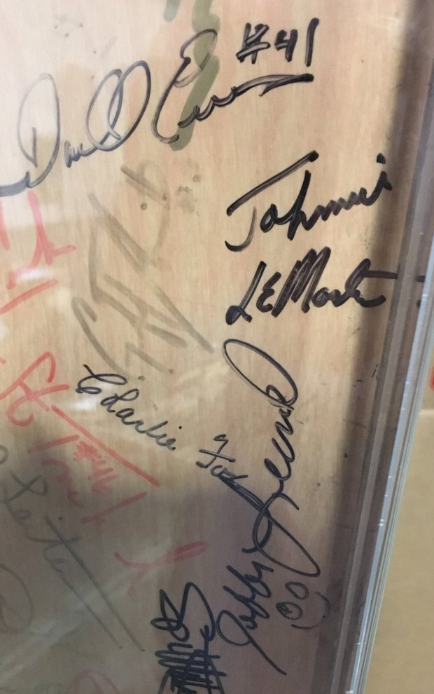 Before the closing of Candlestick Park after the 1999 season, visitingclubhouse manager Harvey Hodgerney asked hundreds of players to sign the door on their way out. Featured here: Johnnie LeMaster, Darrell Evans, Charlie Fox and Jeffrey Leonard. (Photo credit: Daniel Brown, Bay Area News Group)