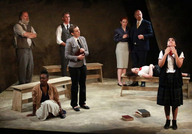 """Gary Landis as Giles Corey, Leslie Ivy as Tituba, Damian Vega as Rev. Samuel Parris, Maria Giere Marquis as Rev. John Hale, Marjorie Hazeltine as Ann Putnam, Michael Champlin as Thomas Putnam, Ellen Schwartz as Betty Parris, and Nicole Apostol Bruno as Abigail Williams, from left, in the Los Altos Stage Company's production of """"The Crucible,"""" playing Sept. 7 through Oct. 1, 2017, at the Bus Barn Theatre in Los Altos. (Richard Mayer / Los Altos Stage Company)"""