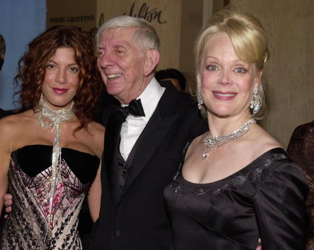 380687 49: Actress Tori Spelling, left, her father producer Aaron Spelling and wife Candy Spelling arrive October 28, 2000 at The Carousel of Hope Ball benefiting The Barbara Davis Center for Childhood Diabetes at the Beverly Hills Hilton in Beverly Hills, CA. (Photo by Chris Weeks/Liaison)