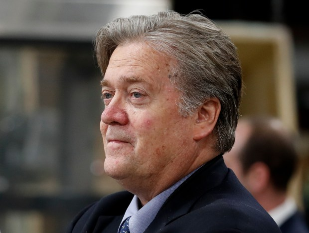 FILE - In this April 29, 2017, file photo, Steve Bannon, chief White House strategist to President Donald Trump, tours The AMES Companies, Inc., with the president in Harrisburg, Pa. (AP Photo/Carolyn Kaster, File)