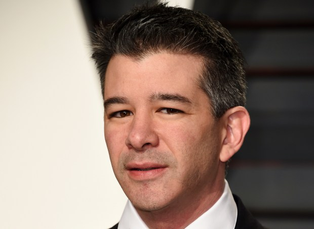 FILE - In this Feb. 26, 2017, file photo, Uber CEO Travis Kalanick arrives at the Vanity Fair Oscar Party in Beverly Hills, Calif. Ryan Graves, Uber's chief of global operations, resigned and investors sued the company's former CEO. Graves told Uber staff in an email Thursday, Aug. 10, that he will transition out of his role as senior vice president of global operations in mid-September. That board, and its support for former CEO Travis Kalanick, was the subject of a lawsuit filed Thursday in Delaware Chancery Court by Benchmark Capital Partners. (Photo by Evan Agostini/Invision/AP, File)