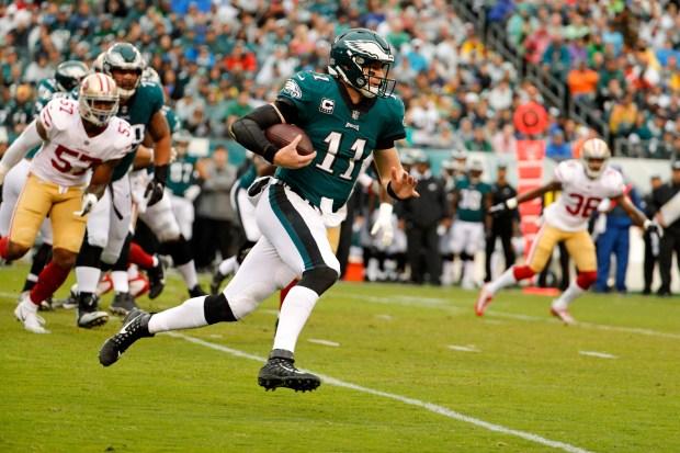 Philadelphia Eagles quarterback Carson Wentz (11) runs the ball during the first half of an NFL football game against the San Francisco 49ers, Sunday, Oct. 29, 2017, in Philadelphia,. (AP Photo/Chris Szagola)