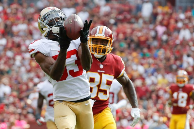 San Francisco 49ers cornerback Rashard Robinson (33) intercepts a pass intended for Washington Redskins tight end Vernon Davis (85) during the first half of an NFL football game in Landover, Md., Sunday, Oct. 15, 2017. (AP Photo/Alex Brandon)