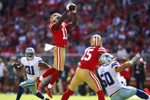 SANTA CLARA, CA - OCTOBER 22: Marquise Goodwin #11 of the San Francisco 49ers makes a catch against the Dallas Cowboys during their NFL game at Levi's Stadium on October 22, 2017 in Santa Clara, California. (Photo by Ezra Shaw/Getty Images)