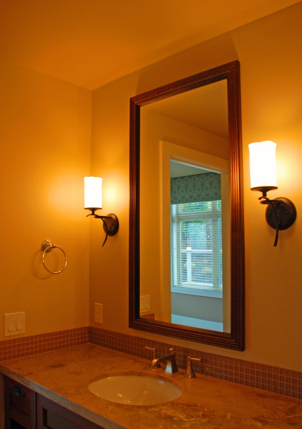 Sconces flanking your bathroom mirror will not only look great, they will make you look even better.