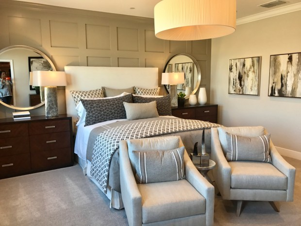 A gray accent wall helps create the inspiration for gray accents used throughout this master bedroom