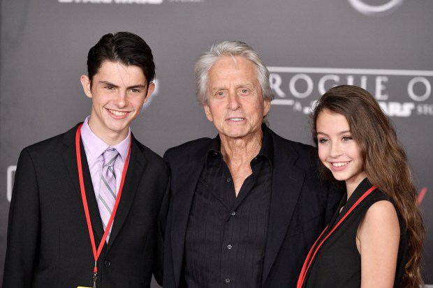"HOLLYWOOD, CA - DECEMBER 10: (L-R) Dylan Michael Douglas, Michael Douglas and Carys Zeta-Douglas attend the premiere of Walt Disney Pictures and Lucasfilm's ""Rogue One: A Star Wars Story"" at the Pantages Theatre on December 10, 2016 in Hollywood, California. (Photo by Mike Windle/Getty Images)"