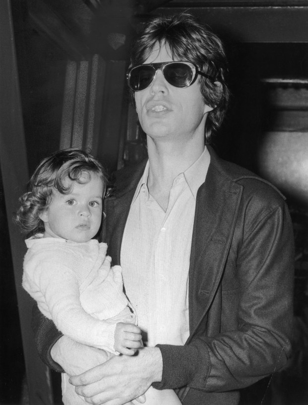Rolling Stones singer Mick Jagger with his daughter Jade in 1973. (Photo by Evening Standard/Getty Images)