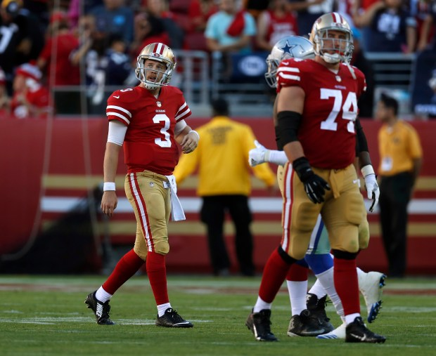 San Francisco 49ers starting quarterback C.J. Beathard (3) walks off the field after failing to convert a fourth down against the Dallas Cowboys late in the fourth quarter of their NFL game at Levi's Stadium in Santa Clara, Calif. on Sunday, Oct. 22, 2017. (Nhat V. Meyer/Bay Area News Group)