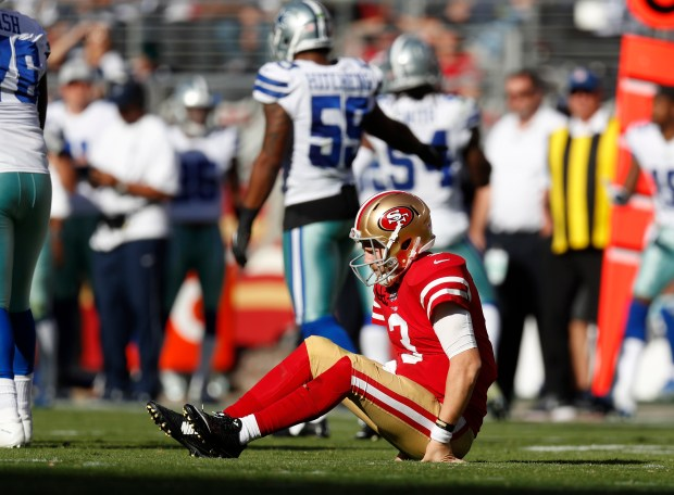 San Francisco 49ers starting quarterback C.J. Beathard (3) gets up after being tackled after he threw the ball against the Dallas Cowboys in the fourth quarter of their NFL game at Levi's Stadium in Santa Clara, Calif. on Sunday, Oct. 22, 2017. (Nhat V. Meyer/Bay Area News Group)