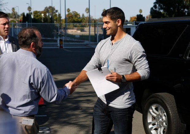 New 49ers quarterback Jimmy Garoppolo, right, is greeted by Bob Lange, VP of Communications, as Garoppolo arrives at the Niners facility in Santa Clara, California, Tuesday, Oct. 29, 2017. (Patrick Tehan/Bay Area News Group)