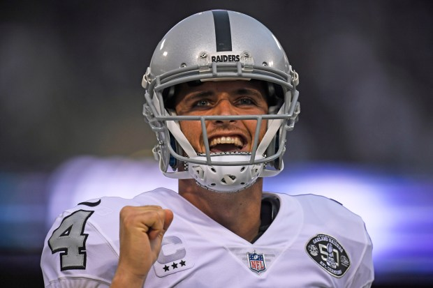 Oakland Raiders quarterback Derek Carr (4) celebrates after teammate Amari Cooper (89) scores on a 45-yard touchdown pass against the Kansas City Chiefs in the first quarter of their NFL game at the Coliseum in Oakland, Calif. on Thursday, Oct. 19, 2017. (Jose Carlos Fajardo/Bay Area News Group)