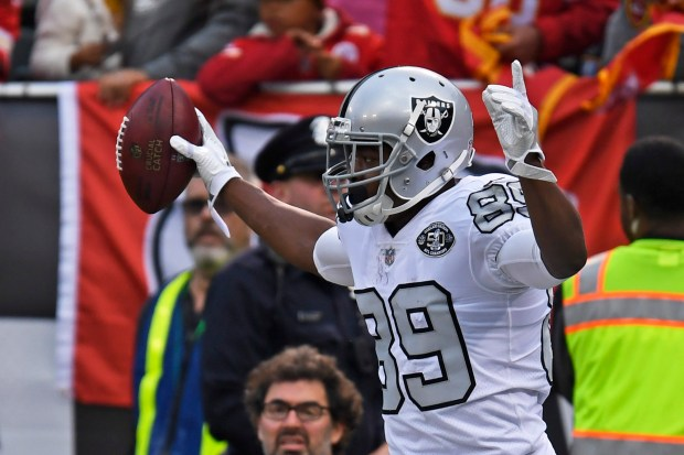 Oakland Raiders' Amari Cooper (89) celebrates his 38-yard touchdown pass against the Kansas City Chiefs in the first quarter of their NFL game at the Coliseum in Oakland, Calif. on Thursday, Oct. 19, 2017. (Jose Carlos Fajardo/Bay Area News Group)