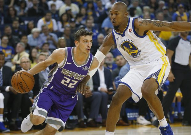 Golden State Warriors forward David West (3) guards Sacramento Kings guard David Stockton (22) in the second quarter at Oracle Arena on Friday, Oct. 13, 2017, in Oakland, Calif. (Jim Gensheimer/Bay Area News Group)