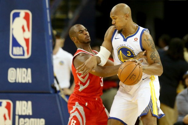 2511080bbdea Golden State Warriors  David West (3) trip to drible past Houston Rockets