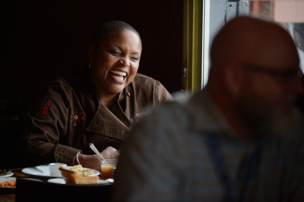 Tanya Holland shares a laugh at Brown Sugar Kitchen in Oakland, Calif., on Thursday, Oct. 23, 2014. (Dan Honda/Bay Area News Group)